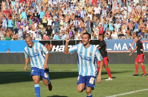 Xavi Torres celebra el tercer gol del Málaga